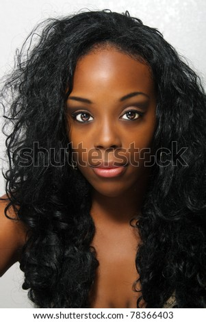 An extraordinarily beautiful young black woman with amazingly captivating eyes.