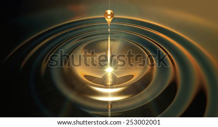 An extreme close up of a drop of oil creating ripples on an isolated black background - stock photo