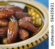An extreme close up of dates in bowl. - stock photo