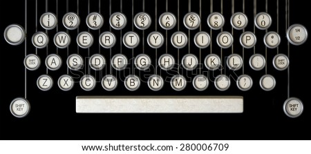 An extreme close up of the keys of a vintage typewriter on a dark background - stock photo