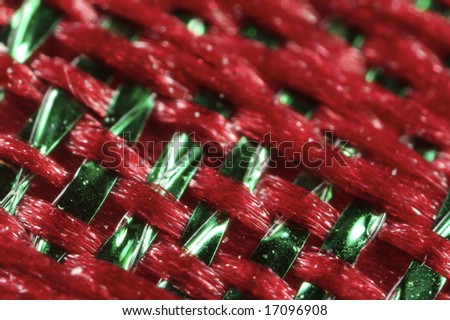 An extreme closeup of a red and green woven fabric.