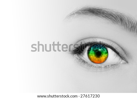 An extreme closeup of a woman's eye which is in rainbow colors and her skin is in black and white. - stock photo
