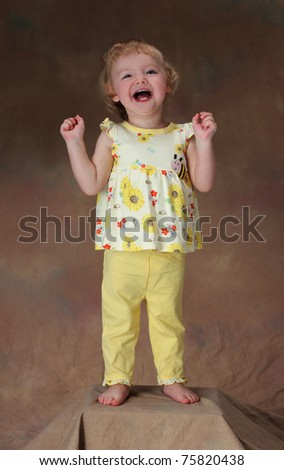 An Exuberant Little Girl - stock photo