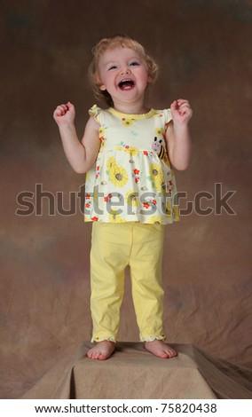 An Exuberant Little Girl - stock photo
