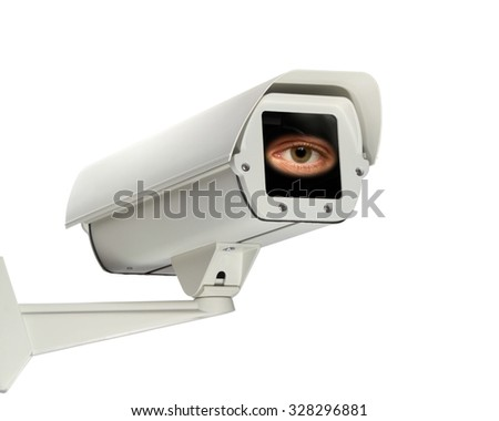 An eye looks out from a security camera.
