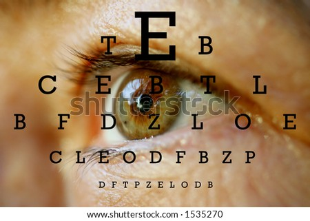an eye with test vision chart - stock photo