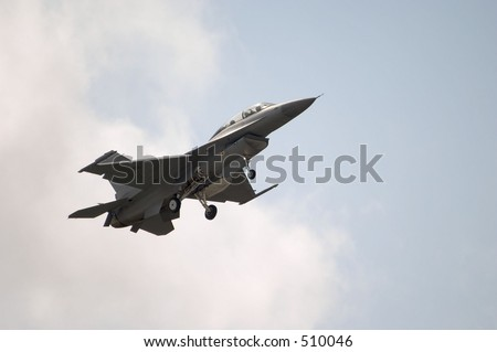 An F-16 Jet coming in for a landing - stock photo