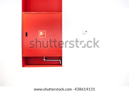 an fire hose hanging on the wall - stock photo