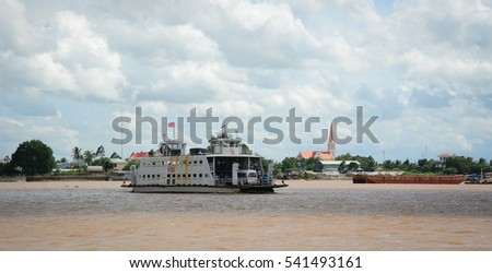 An Giang, Vietnam - Aug 7, 2016. A ferry on the Bassac River in Southern Vietnam. The Bassac River is the first and main distributary of the Mekong.