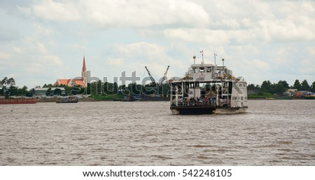 An Giang, Vietnam - Aug 7, 2016. A ferry on the Mekong River in Chau Doc, Vietnam. The Mekong is a trans-boundary river in Southeast Asia. It is the world's 12th-longest river.