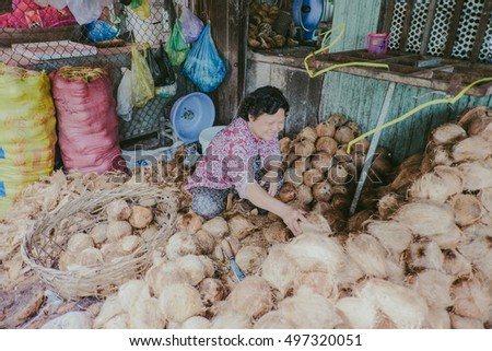 An Giang, Vietnam - October 12th, 2016: a portrait of woman with smile happy, she sells dry coconut.