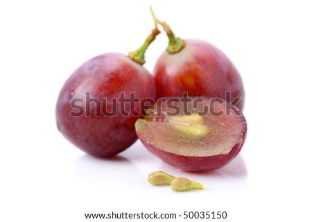 An half and fullness grapes with seeds isolated over white background. - stock photo