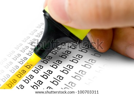 An hand who writes with an yellow highlighter on a paper - stock photo