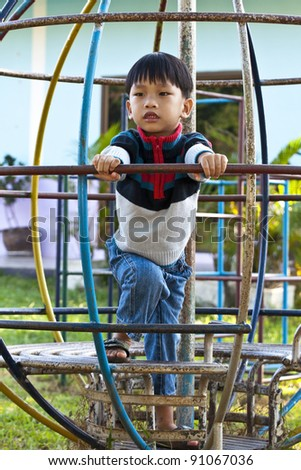 An handsome Asian kid of Thailand  in Playground - stock photo