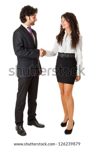 An handsome businessman and a gorgeous businesswoman standing over a white background