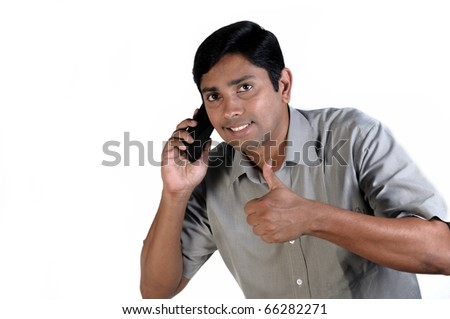 An handsome Indian businessman on call all the time - stock photo