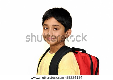 An handsome Indian kid getting ready for school - stock photo