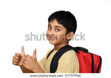 An handsome Indian kid happy to go to school - stock photo