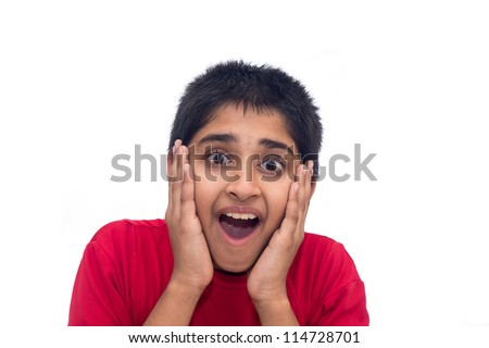 An handsome indian kid looking very excited - stock photo