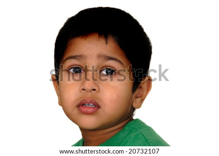An handsome Indian kid looking very sad - stock photo