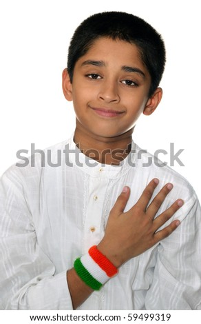 An handsome Indian kid showing his love for the country - stock photo