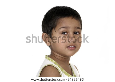 An handsome Indian kid smiling nicely for you - stock photo