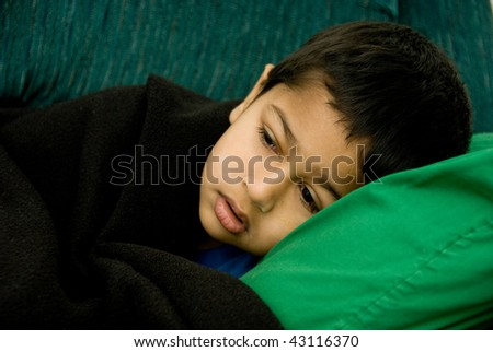 An handsome Indian kid very sick - stock photo