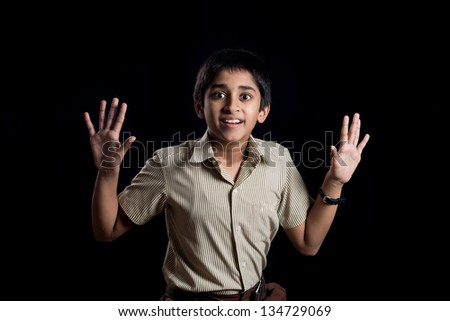An handsome school kid looking very scared - stock photo