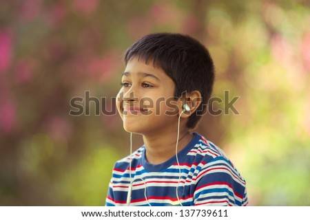 An handsome toddler having fun in the park - stock photo
