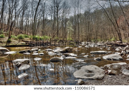 An HDR landscape of a quiet serene mountain stream in the Appalachian mountains of western Maryland in Autumn - stock photo