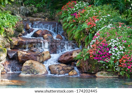 An HDR landscape of fall colors and a waterfall. - stock photo