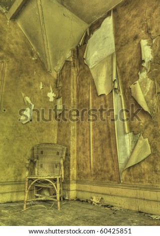 An HDR photo of a chair in a derelict building - stock photo