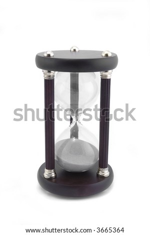 An hour glass isolated on a white background. - stock photo