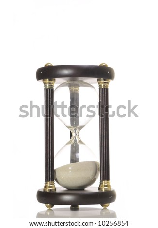 An hourglass against a white background. - stock photo