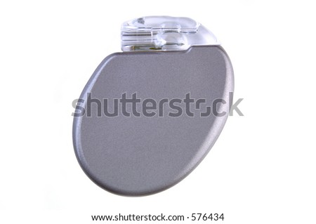 An ICD (Implantable Cardioverter Defibrillator) with pacemaker, 11mm thin, 30cc volume, 2.9 ounces, will be surgically placed in the chest wall.(12MP camera, isolated, macro) - stock photo