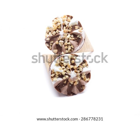 an ice cream and chocolate with hazelnut pieces - stock photo