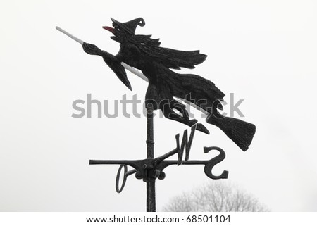 An Ice Witch riding a broom - stock photo