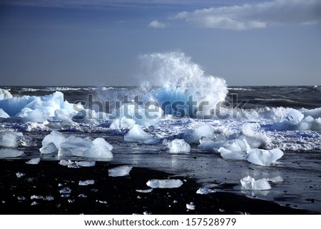 An iceberg being broken by the waves Iceland - stock photo