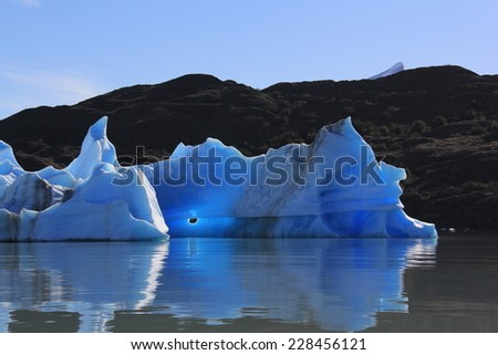 An iceberg calved from Upsala glacier floating in the Argentino Lake. The picture was taken from the boat that took us to see the Upsala glacier.  - stock photo