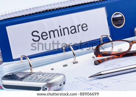 an icon image for further education, training and adult education. folder and documents in a seminar - stock photo