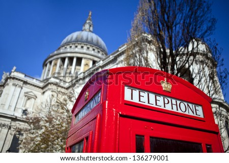 An iconic British Red Telephone Box outside St. Paul's Cathedral in London - stock photo