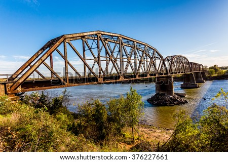 An Iconic Old Metal Truss Railroad Bridge in Texas. - stock photo