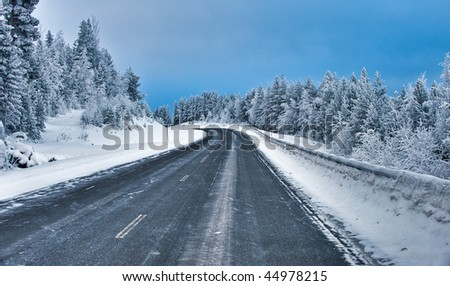 an icy road in the north of Sweden - stock photo
