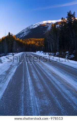 An icy stretch of road during winter in the mountains.