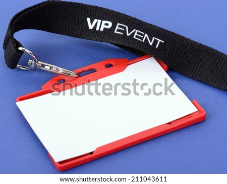 an id badge for a VIP event on a blue background, focus on the vip text - stock photo
