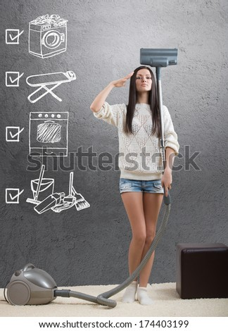 An ideal homemaker with weekly chore checklist - stock photo