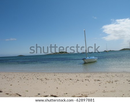 An idyllic beach in the isles of Scilly, UK - stock photo