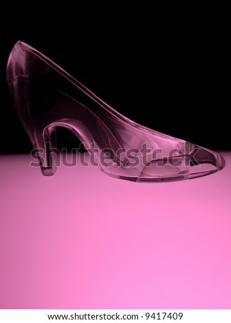 an illuminated glass slipper in cool pink tones - stock photo