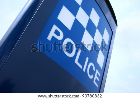 An illuminated sign outside a police station in the UK. - stock photo