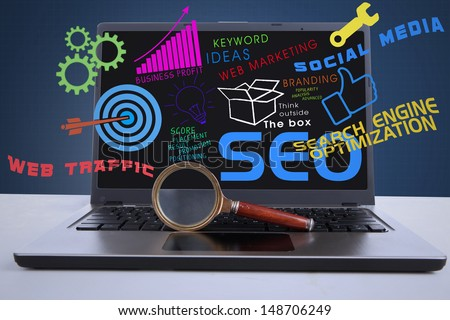 An illustration featuring a laptop computer with SEO concept and a magnifying glass in front of the laptop - stock photo